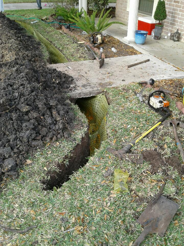trenching front yard before installing tree root barrier